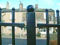 Powder coated vertical bar railings with ball tops close up photo